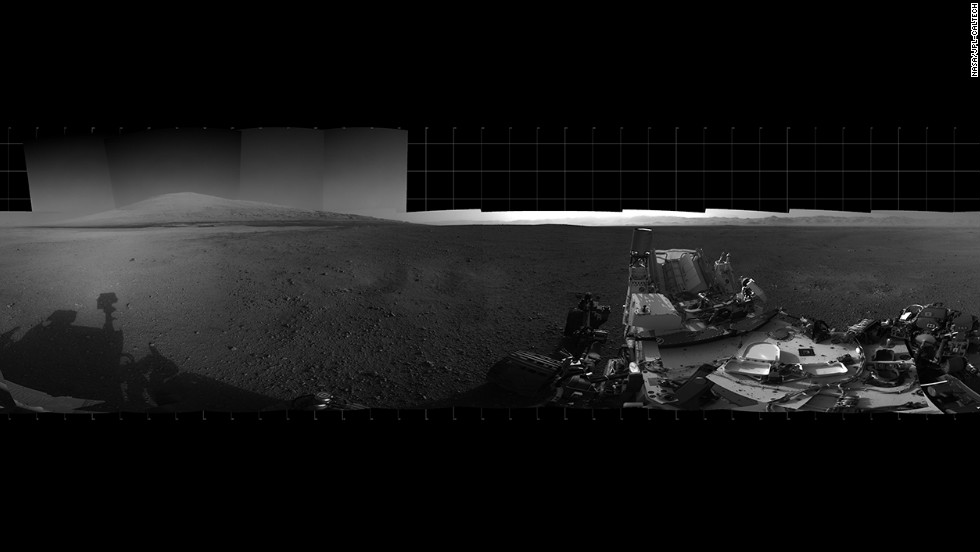 With the addition of four high-resolution Navigation Camera, or Navcam, images, taken on August 18, 2012. Curiosity's 360-degree landing-site panorama now includes the highest point on Mount Sharp visible from the rover. Mount Sharp's peak is obscured from the rover's landing site by this highest visible point.