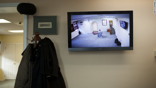 A CCTV monitor displays a man praying February 25 at the Iqra Masjid in Brooklyn, New York.