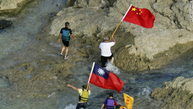 Activists walk on an island claimed by both Japan and China in the East China Sea on August 15.