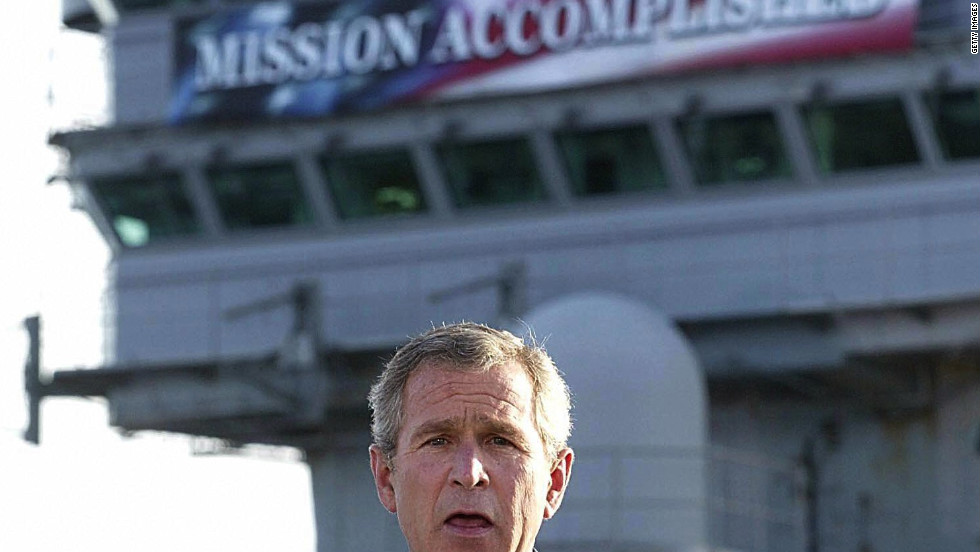 "<strong>PROMISE: ""Mission Accomplished.""</strong> The banner aboard the USS Abraham Lincoln heralded Bush's announcement of an end to major combat operations in Iraq just months after the invasion. The fighting, however, would drag on for seven years."
