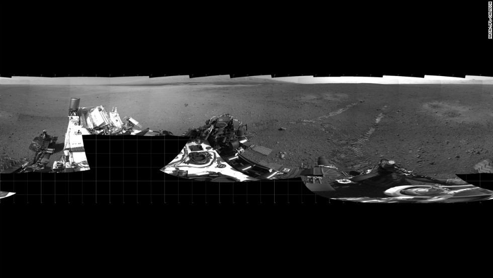 The Mars rover Curiosity moved about 15 feet forward and then reversed about 8 feet during its first test drive on August 22, 2012. The rover's tracks can be seen in the right portion of this panorama taken by the rover's navigation camera.