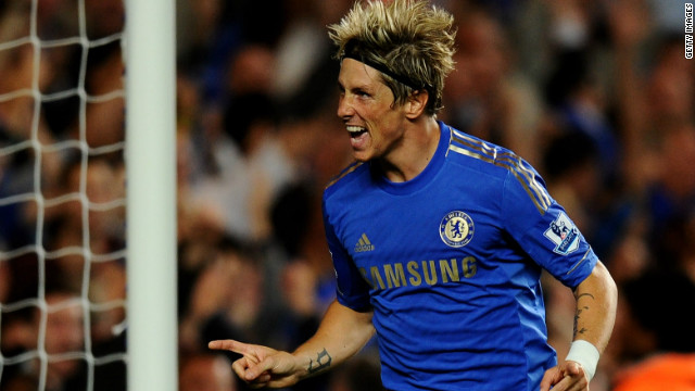 Fernando Torres celebrates scoring Chelsea's decisive third goal at Stamford Bridge in the 4-2 win over Reading.