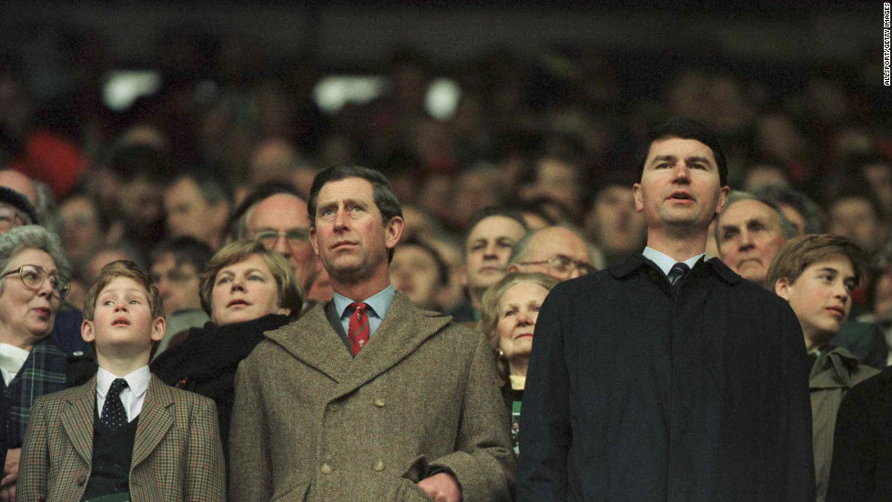 Charles, the Prince of Wales, and his son Prince Harry stand for the anthems during the Wales versus Scotland game in Cardiff, Wales, on February 17, 1996.