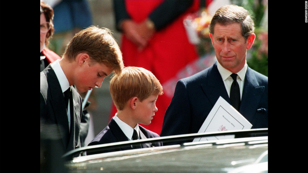 Left to right: Princes William, Harry and their father Prince Charles wait in front of the Westminster Abbey in London after the funeral ceremony of Diana Princess of Wales on September 6, 1997.