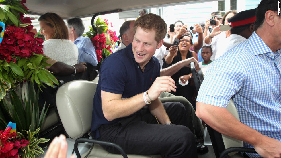 Prince Harry climbs on board a specially decorated golf buggy as he goes on a tour of Harbour Island in Nassau, Bahamas, on March 4, 2012. The Prince was visiting the Bahamas as part of a Diamond Jubilee tour as a representative of Queen Elizabeth II.