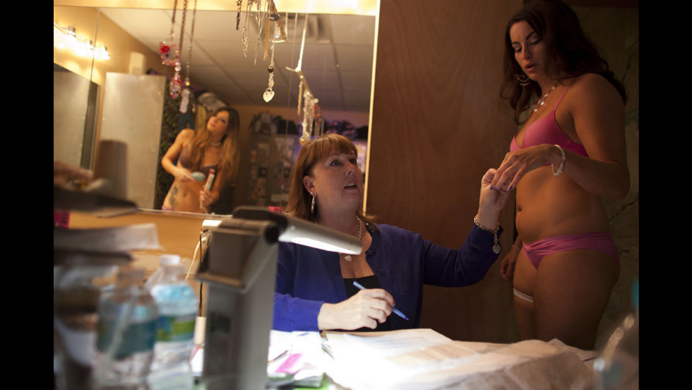 Karafas checks out a dancer backstage at Thee DollHouse.