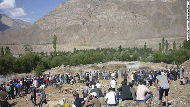 Pamiri people bury those killed during July 24 military action in Khorog, Tajikistan.