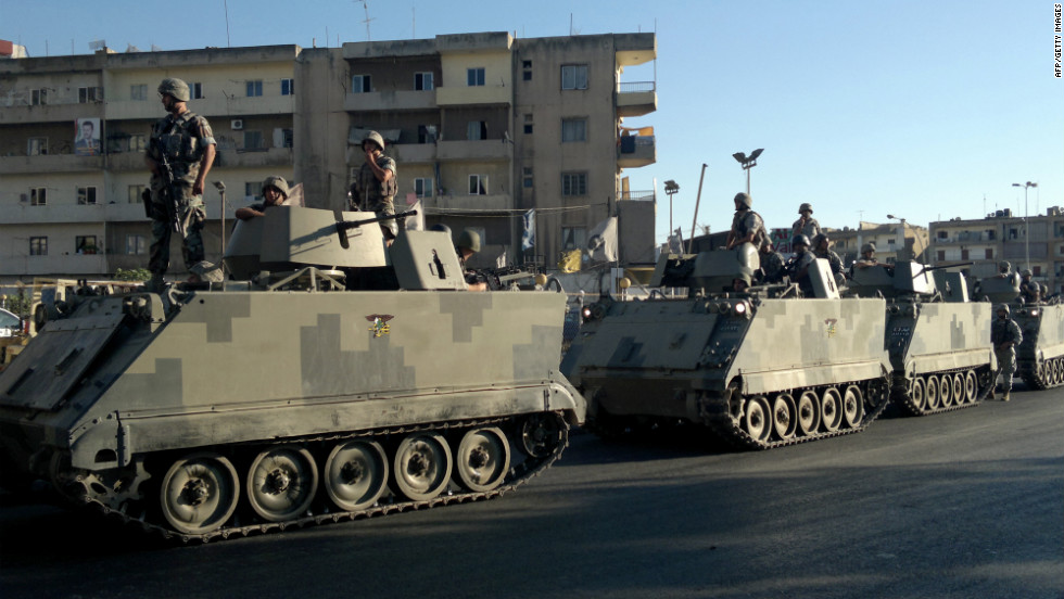 Lebanese army commandos stand their ground Wednesday in Tripoli as fighting goes on between factions supporting and opposing the regime in neighboring Syria.