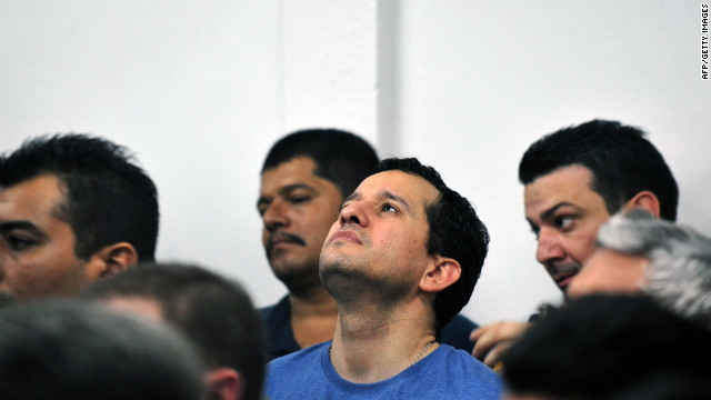 Henry Farinas (C), alleged target of the attack that killed Argentine singer and songwriter Facundo Cabral on July 9, 2011, attends a trial in Managua on August 22, 2012.