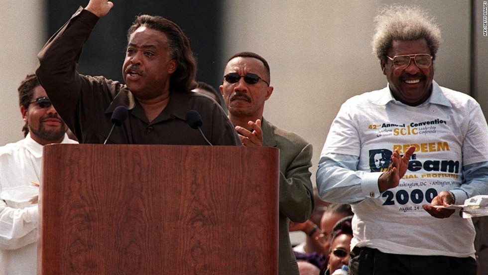 "King applauds during a speech in August 2000 by the Rev. Al Sharpton during a celebration honoring the 37th anniversary of Martin Luther King, Jr.'s ""I Have a Dream"" speech in Washington, D.C."