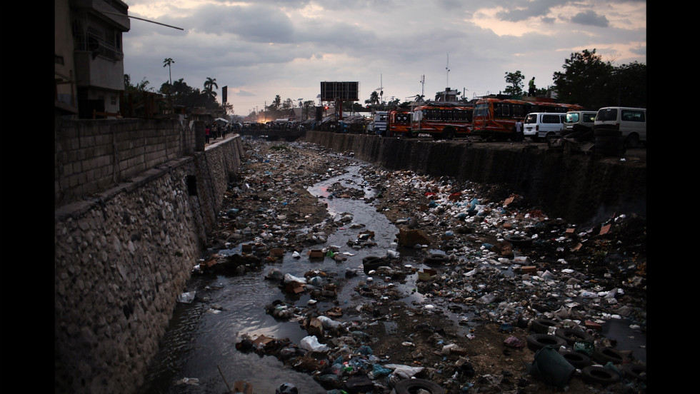 A March 5 photo shows garbage littering a canal in Port-au-Prince.