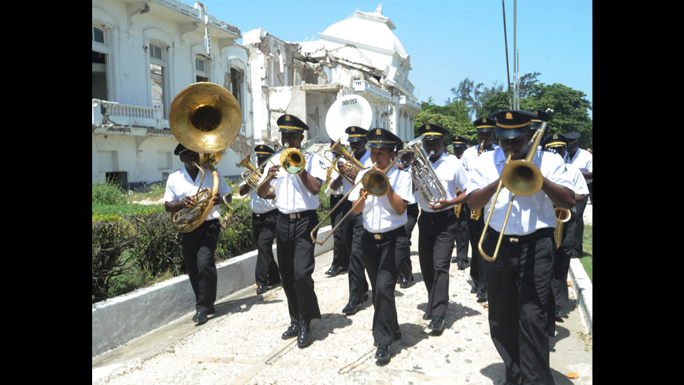 A band plays during an announcement on August 22 that the National Palace in Port-au-Prince will be demolished. The country is still in crisis after the deadly 2010 earthquake. Now a hurricane is threatening to bring even more destruction to the island.