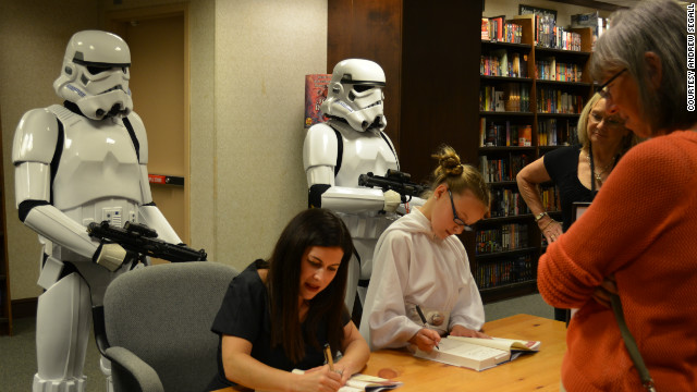 """""""Bullied"""" author Carrie Goldman signs copies of her books with daughter Katie."""