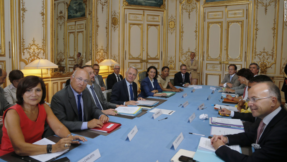 French Prime Minister Jean-Marc Ayrault, center left, heads a meeting with ministers and members of the Romeurope National Collective of Human Rights for emergency talks on the handling of an estimated 15,000 Roma living in camps across France on Wednesday, August 22, at the Matignon Hotel in Paris.