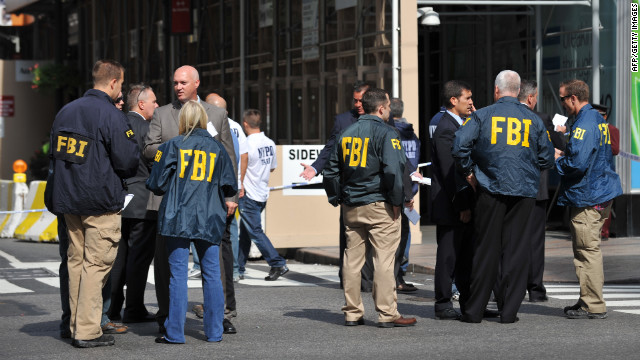 FBI agents gather at the scene of the shooting.