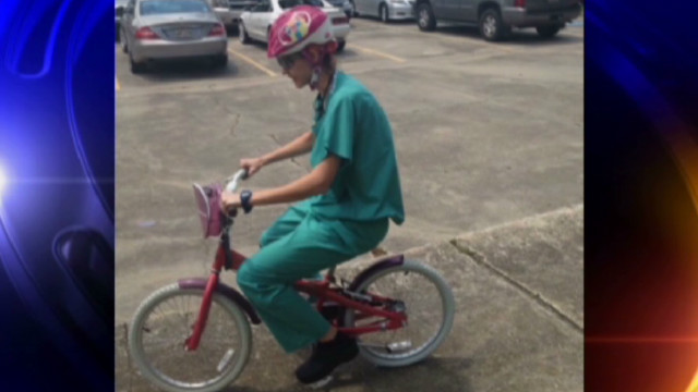 dnt doctor pedals girl's bike to surgery_00004222