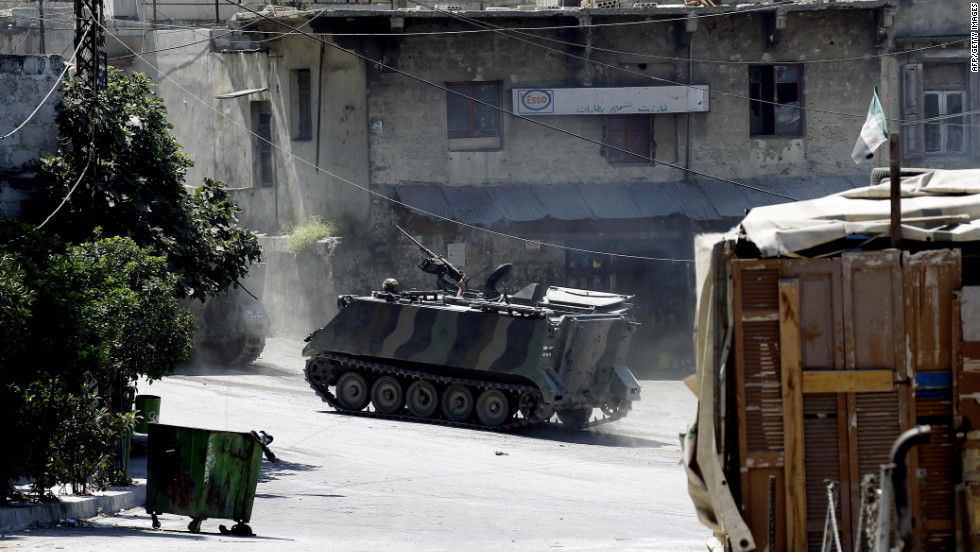 Lebanese army commandos drive an armored personnel carrier in the Bab al-Tabbaneh neighborhood.