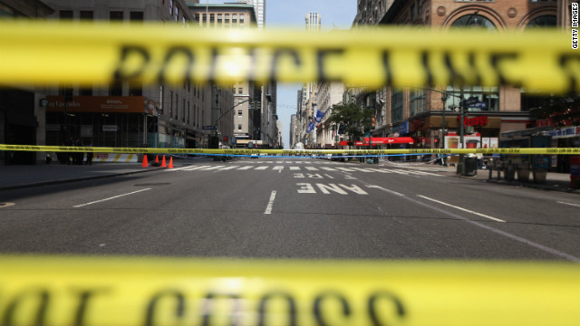 A section of Fifth Avenue sits closed by police outside the Empire State Building after it re-opened to the public after a shooting outside the building August 24, 2012 in New York City.