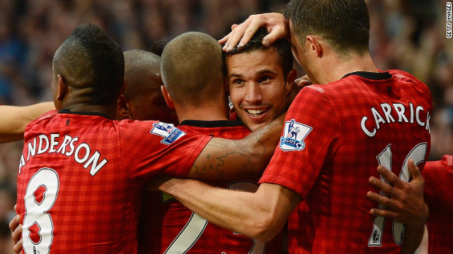 Robin van Persie celebrates his first goal for Manchester United
