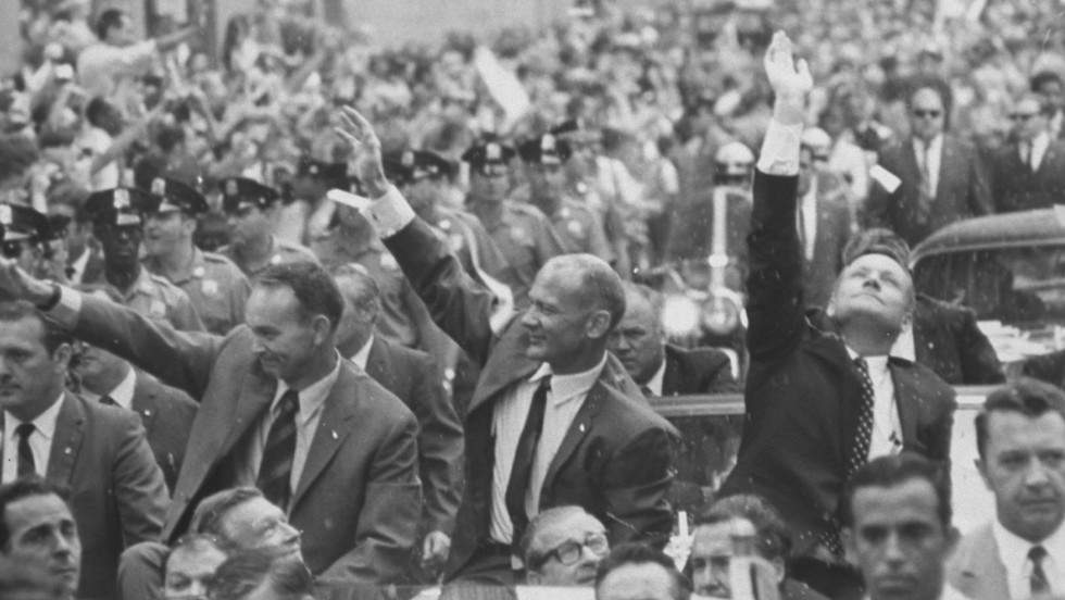 Armstrong, Aldrin and Collins wave to crowds at a parade held in August 1969 celebrating their voyage.