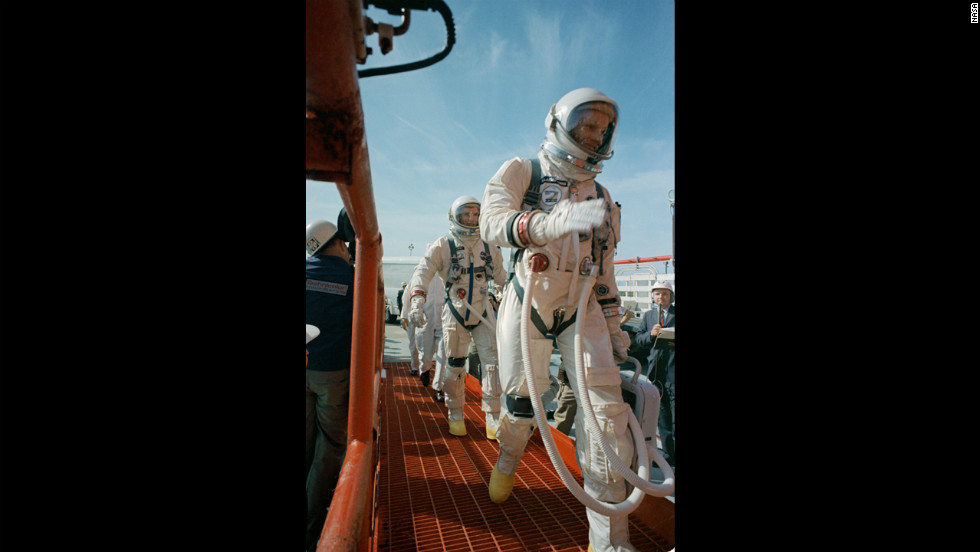 Commander Neil Armstrong, right, and pilot David R. Scott prepare for the launch of Gemini 8 on March 16, 1966. In orbit, Armstrong had to bring the capsule under control when it began to spin out of control after docking with an unmanned target vehicle, and the mission was aborted.