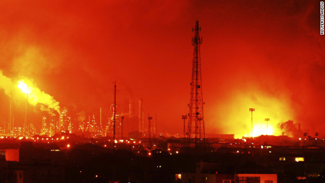 Fire glows at the site of an explosion at Amuay oil refinery in Punto Fijo, Venezuela, on Saturday.