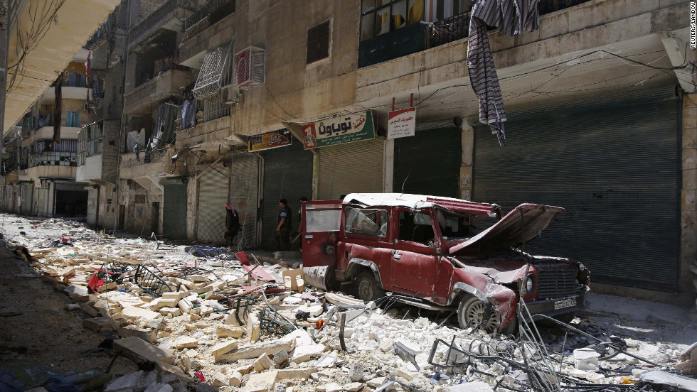 A street in Aleppo is covered in rubble from heavy fighting between rebels and Syrian government forces.