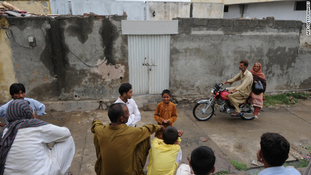 Pakistanis gather  in Islamabad, Pakistan, on August 22 outside the closed house of a Christian girl accused of blasphemy.