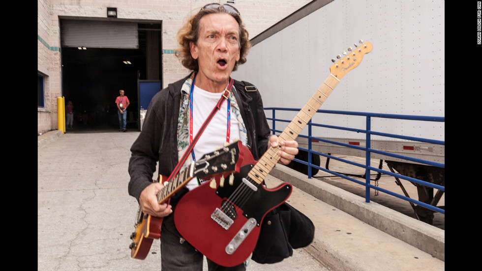 House band leader G.E. Smith arrives at the convention center Saturday with a pair of guitars.