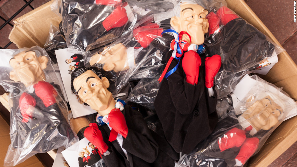 Hand puppets of Mitt Romney, Newt Gingrich and Ron Paul are for sale in Tampa.