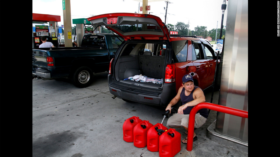 Ocean Springs, Mississippi, resident Charles Bartlett fills several gas containers in preparation for Isaac.