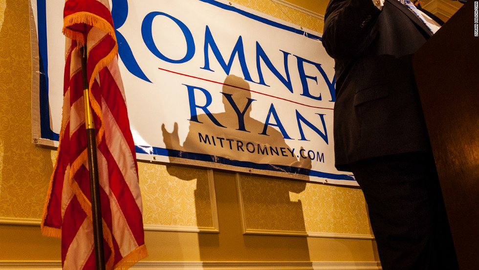 New Jersey Gov. Chris Christie casts a shadow on a Romney/Ryan campaign sign while speaking to delegates from Michigan. Christie will deliver the convention's keynote address Tuesday night.