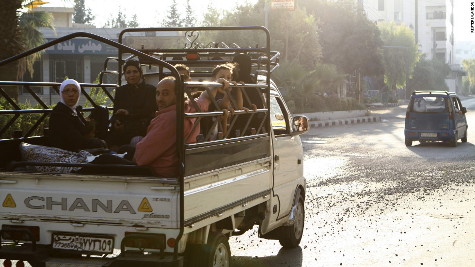 Civilians flee the violence from the Damascus suburb of Kafr Batna.