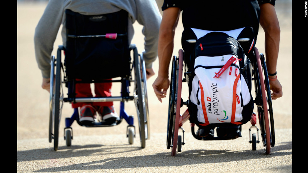 Paralympic athletes from Switzerland push their wheelchairs ahead of the London 2012 Paralympic Games.