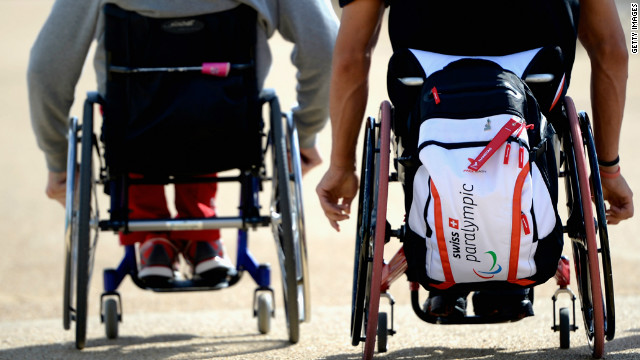 Paralympic athlethes of Switzerland push their wheel chairs ahead of the London 2012 Paralympic Games.
