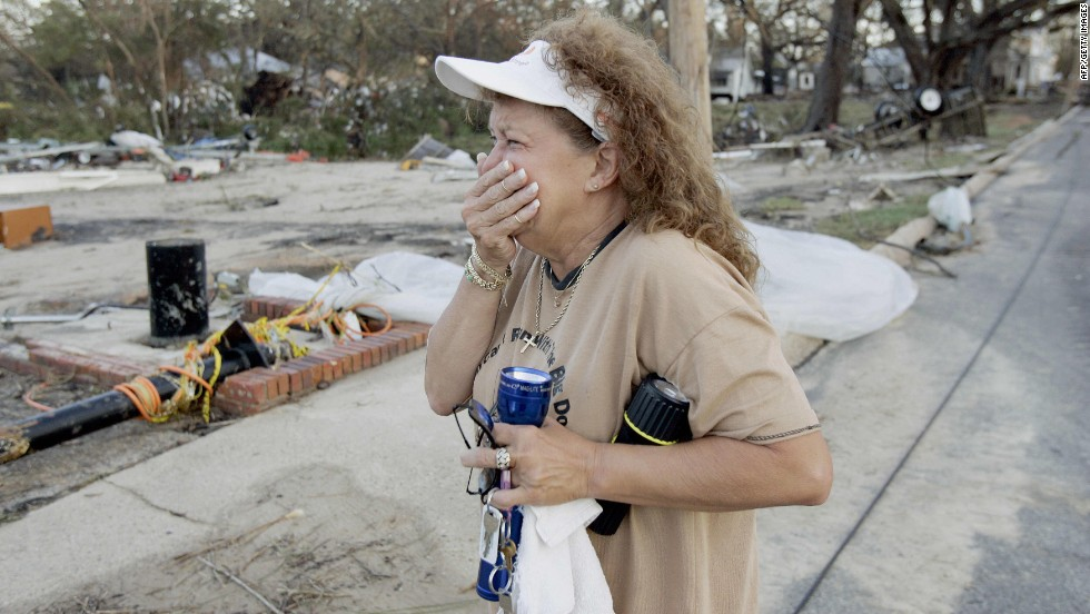 A woman cries after returning to her house and business, destroyed by Hurricane Katrina, on August 30, 2005, in Biloxi, Mississippi.
