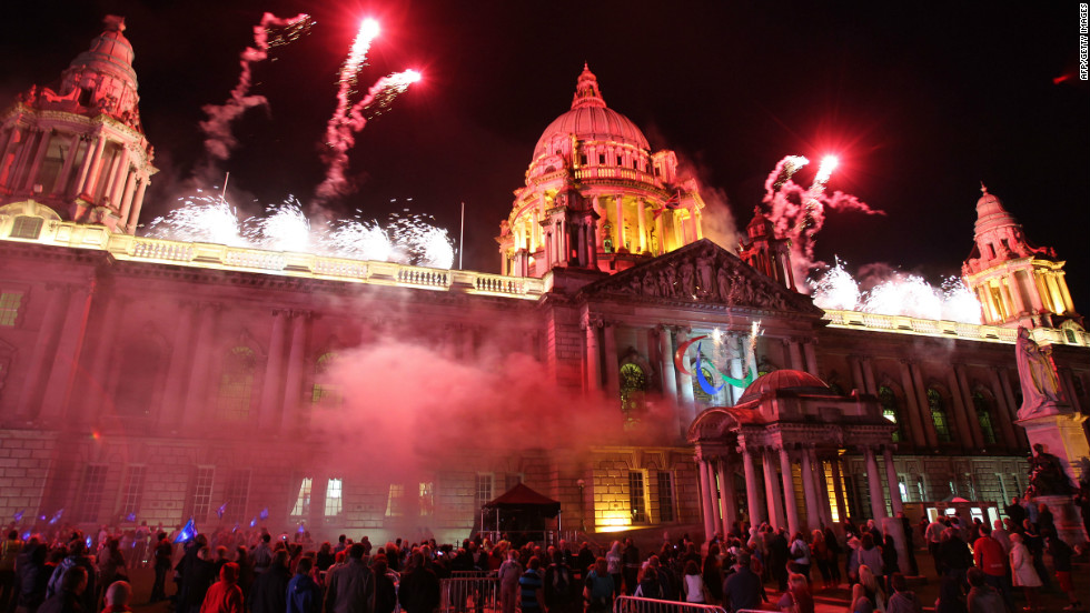 People watch a fireworks display on August 25 after a Paralympic cauldron was lit outside Northern Ireland's parliament in Belfast, the second of four in Britain's capital cities ahead of the 2012 Games.