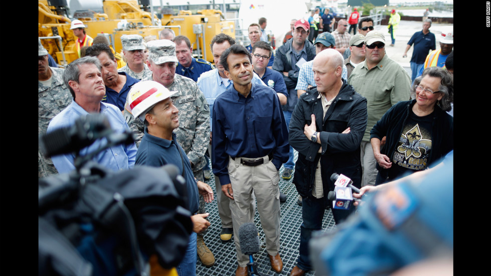 Louisiana Gov. Bobby Jindal and New Orleans Mayor Mitch Landrieu receive an update on the status of the pumping station at the 17th Street Canal in Metairie, Louisiana.