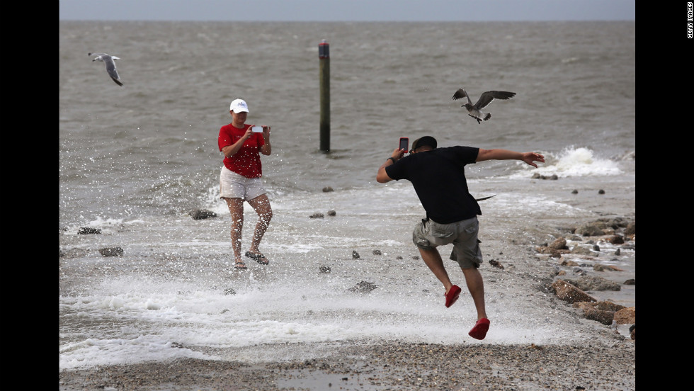 A couple takes photos in Bay St. Louis, Mississippi. Many residents of the area decided to stay in their homes instead of evacuating.