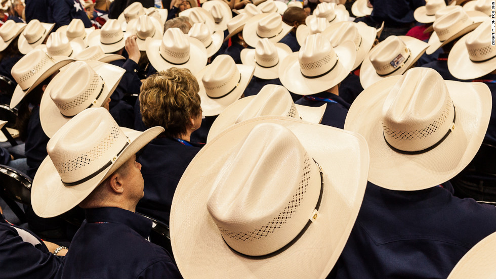 Texas delegates sit on the floor of the Republican National Convention on Tuesday, August 28.