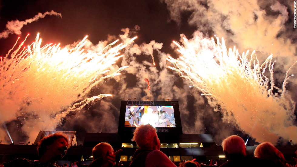 Fans watch fireworks as actress/singer Jordin Sparks performs the national anthem during the opening ceremonies.