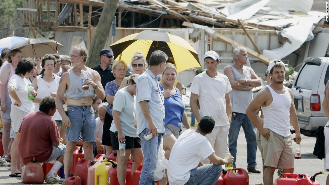 Residents of Saucier, Mississippi, line up to get gas on August 31, 2005.