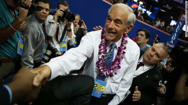 U.S. Rep. Ron Paul (R-TX) (R) greets a supporter as he walks the arena floor during the second day of the Republican National Convention at the Tampa Bay Times Forum on August 28, 2012 in Tampa, Florida. Today is the first full session of the RNC after the start was delayed due to Tropical Storm Isaac.