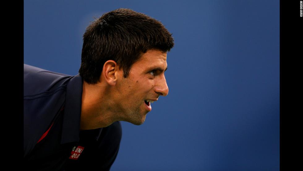 Serbian Novak Djokovic looks on against Italian Paolo Lorenzi during their men's single first-round match.