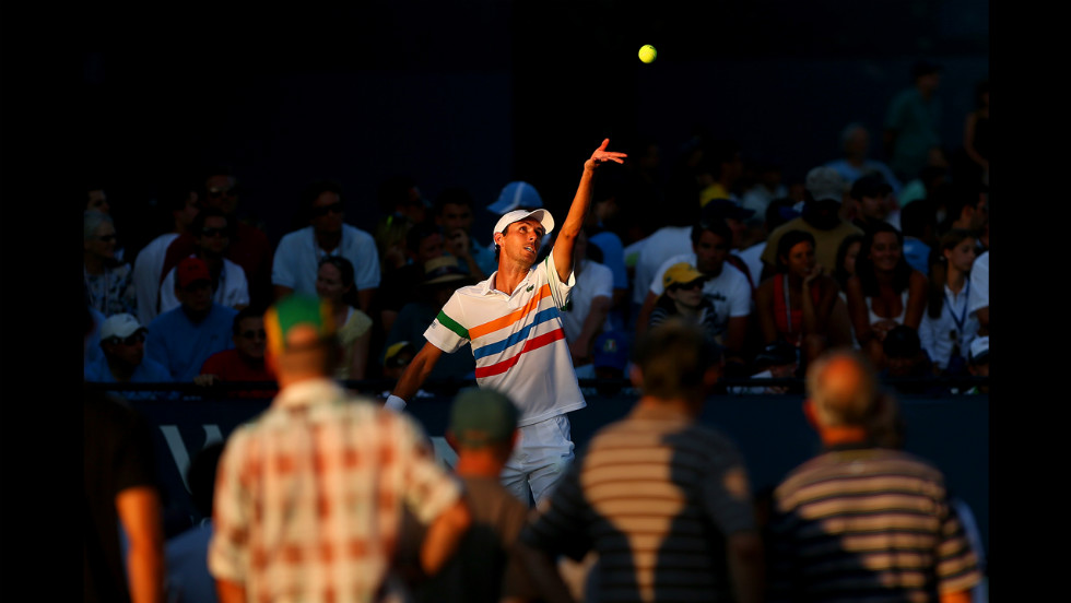 France's Edouard Roger-Vasselin serves the ball against Italian Fabio Fognini of Italy.