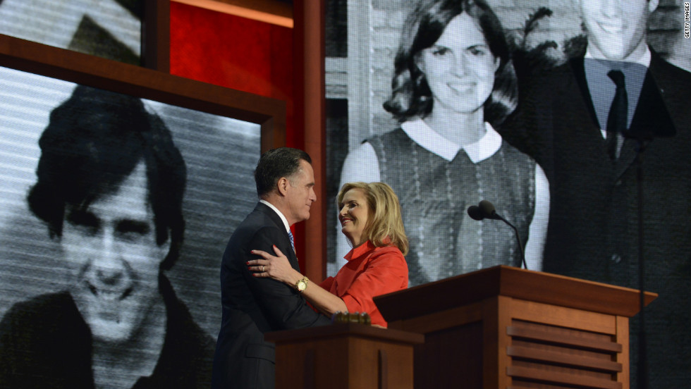 As the crowd cheers, Mitt Romney embraces his wife, Ann, on stage during the convention.