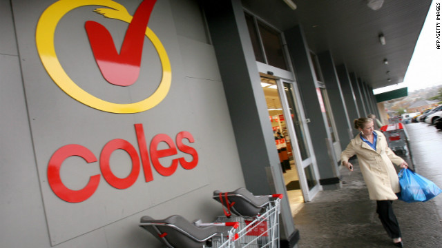 A shopper walks outside a Coles supermarket in Melbourne, Australia.