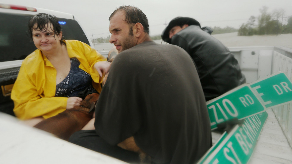 People rest in a rescue truck atop a levee in Plaquemines Parish.