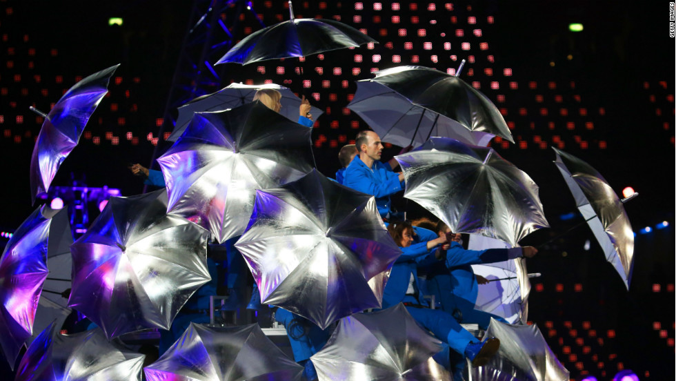 Artists brandished silver umbrellas during their performance.