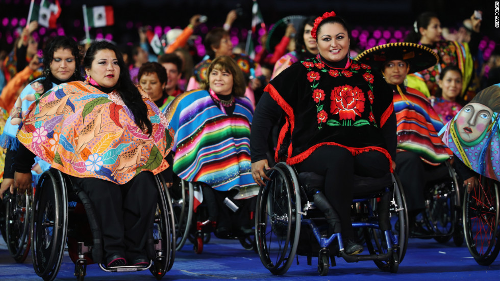 Athletes from Mexico parade in front of a cheering crowd.